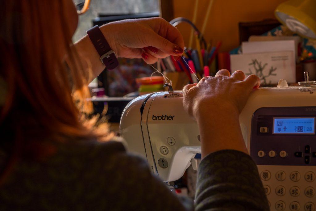 Hannah at sewing machine